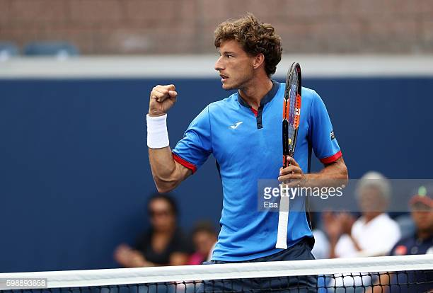 Pablo Carreno Busta of Spain reacts against Dominic Thiem of Austria during his third round Men's Singles match on Day Six of the 2016 US Open at the...
