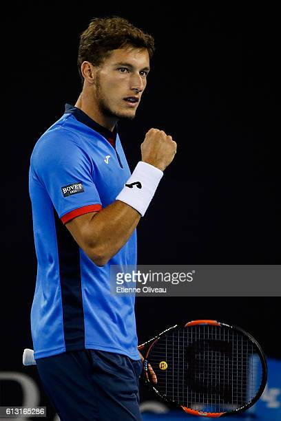 Pablo Carreno Busta of Spain reacts against Milos Raonic of Canada on his Men's singles Quarter Finals match on day seven of the 2016 China Open at...