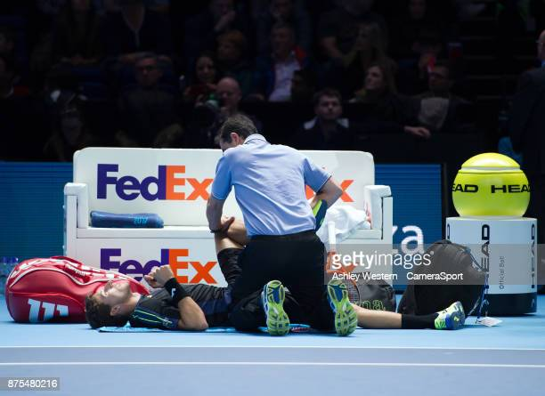 Pablo Carreno Busta of Spain receives medical treatment during his defeat to Grigor Dimitrov of Bulgaria during their Group Pete Sampras match today...