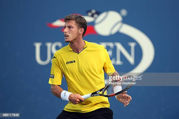 Pablo Carreno Busta of Spain returns a shot against Jerzy Janowicz of Poland during their Men's Singles First Round match on Day One of the 2015 US...