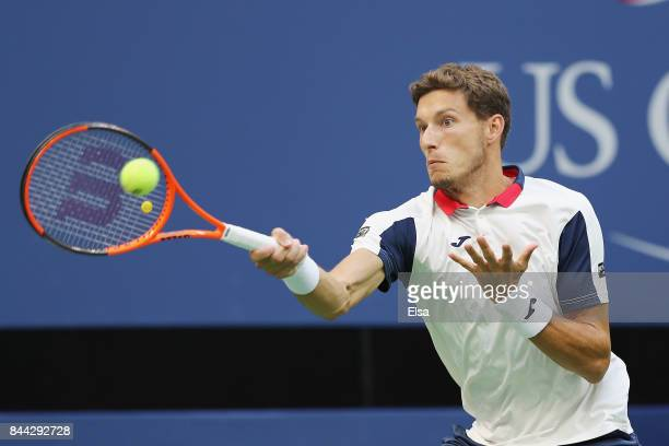 Pablo Carreno Busta of Spain returns a shot against Kevin Anderson of South Africa during their Men's Singles Semifinal match on Day Twelve of the...