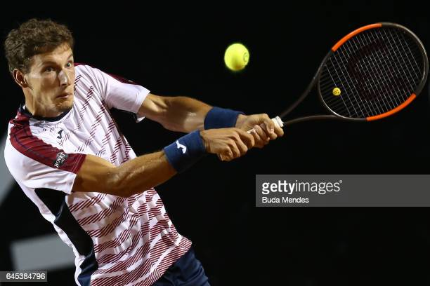 Pablo Carreno Busta of Spain returns a shot to Casper Ruud of Norway during the semifinals of the ATP Rio Open 2017 at Jockey Club Brasileiro on...