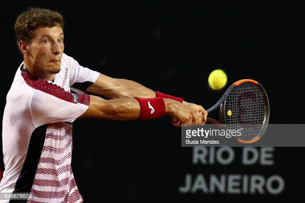 Pablo Carreno Busta of Spain returns a shot to Dominic Thiem of Austria during the Finals of the ATP Rio Open 2017 at Jockey Club Brasileiro on...
