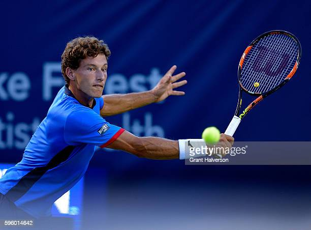 Pablo Carreno Busta of Spain returns a shot to John Millman of Australia in the semifinals of the WinstonSalem Open at Wake Forest University on...