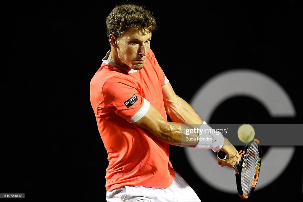 Pablo Carreno Busta of Spain returns a shot to Rafael Nadal of Spain during the Rio Open at Jockey Club Brasileiro on February 16, 2016 in Rio de Janeiro, Brazil.
