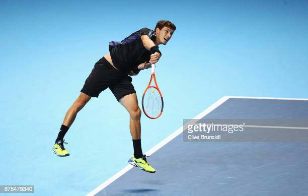 Pablo Carreno Busta of Spain serves in his Singles match against Grigor Dimitrov of Bulgaria during day six of the Nitto ATP World Tour Finals at O2...