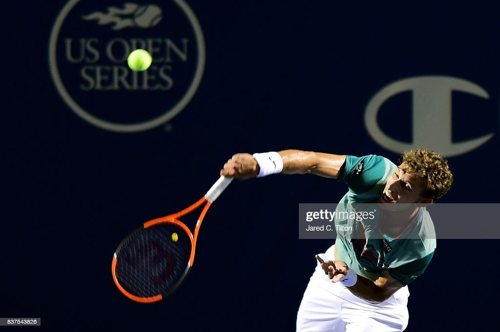 Pablo Carreno Busta of Spain serves to Julien Benneteau of France during the fourth day of the Winston-Salem Open at Wake Forest University on August 22, 2017 in Winston-Salem, North Carolina.