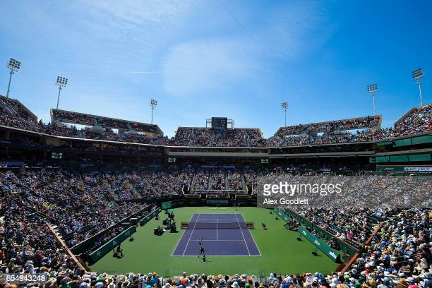 Pablo Carreno Busta of Spain serves to Stan Wawrinka of Switzerland in the men's semifinal on day 13 during the BNP Paribas Open at Indian Wells...