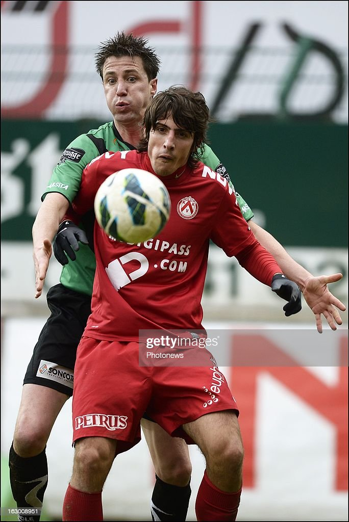 Pablo Chavarria of KV Kortrijk in front of Evens Bernt of Cercle Brugge during the Cofidis Cup semi-final match between KV Kortrijk and Cercle Brugge in the Guldensporen stadium on March 03, 2013 in Kortrijk, Belgium.