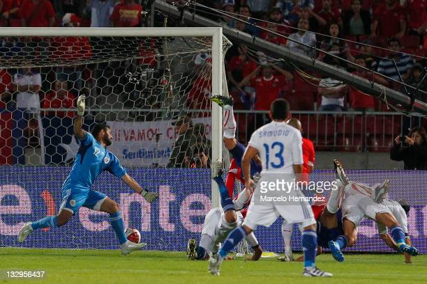 Pablo Contreras from Chile score his goal against Paraguay during the match between Chile and Paraguay as part of the South American Qualifiers for...