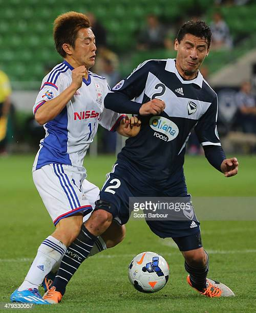 Pablo Contreras of the Victory and Manabu Saito of Yokohama F Marinos compete for the ball during the AFC Asian Champions League match between the...