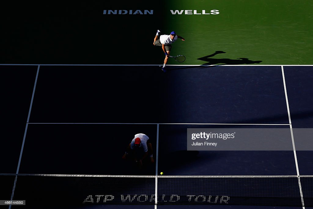 <a gi-track='captionPersonalityLinkClicked' href=/galleries/search?phrase=Pablo+Cuevas&family=editorial&specificpeople=822084 ng-click='$event.stopPropagation()'>Pablo Cuevas</a> and <a gi-track='captionPersonalityLinkClicked' href=/galleries/search?phrase=David+Marrero&family=editorial&specificpeople=5357971 ng-click='$event.stopPropagation()'>David Marrero</a> of Spain in action in their doubles match against Rafael Nadal and Pablo Carreno Busta of Spain during day five of the BNP Paribas Open tennis at the Indian Wells Tennis Garden on March 13, 2015 in Indian Wells, California.