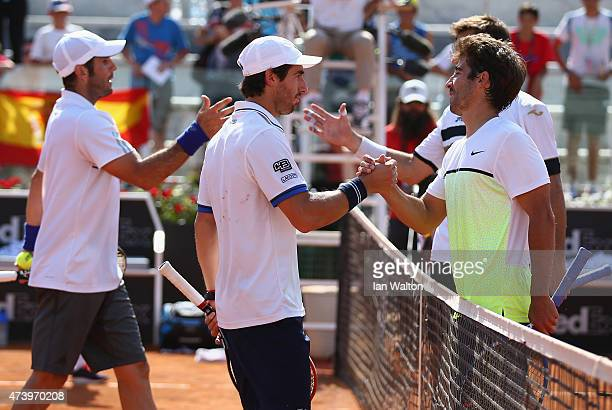 Pablo Cuevas of Argentina and David Marrero of Spain celebrate winning their Men's Doubles Final match against Marcel Granollers and Marc López of...