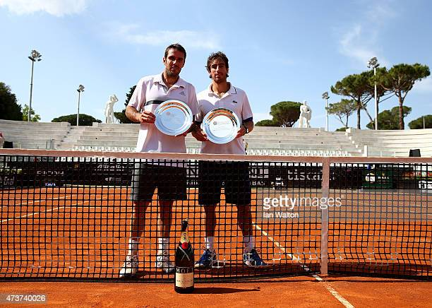 Pablo Cuevas of Argentina and David Marrero of Spain celebrates winning with the trophys after their Men's Doubles Final match against Marcel...