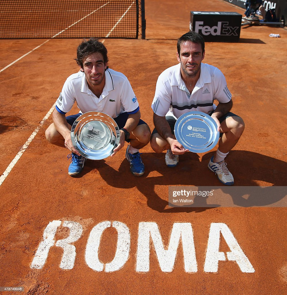 <a gi-track='captionPersonalityLinkClicked' href=/galleries/search?phrase=Pablo+Cuevas&family=editorial&specificpeople=822084 ng-click='$event.stopPropagation()'>Pablo Cuevas</a> of Argentina and <a gi-track='captionPersonalityLinkClicked' href=/galleries/search?phrase=David+Marrero&family=editorial&specificpeople=5357971 ng-click='$event.stopPropagation()'>David Marrero</a> of Spain celebrates winning with the trophys after their Men's Doubles Final match against Marcel Granollers and Marc López of Spain on Day Eight of The Internazionali BNL d'Italia 2015 at the Foro Italico on May 17, 2015 in Rome, Italy.