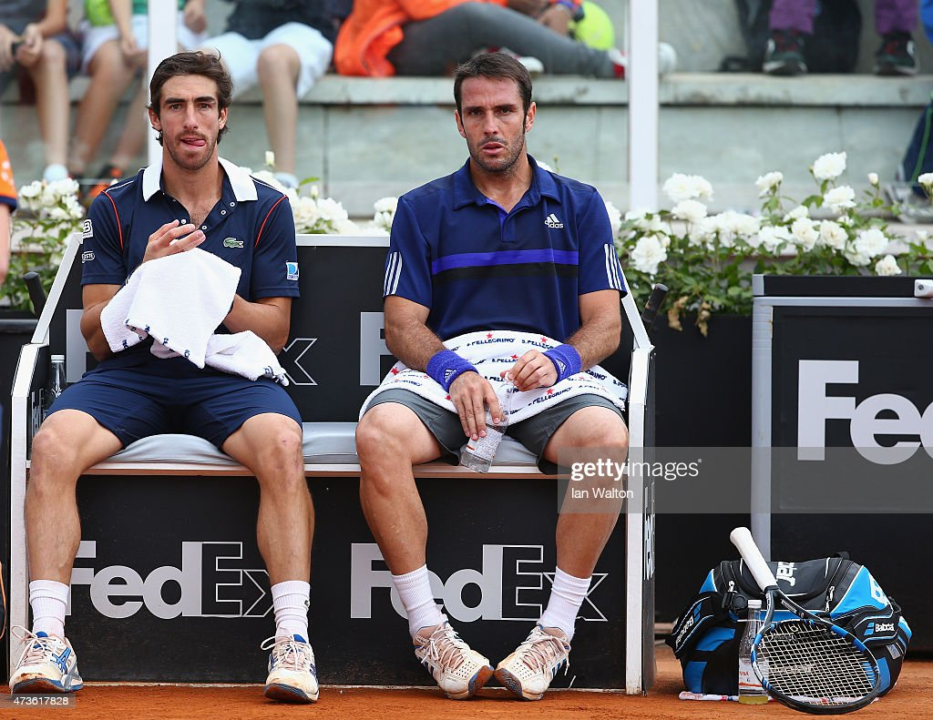 <a gi-track='captionPersonalityLinkClicked' href=/galleries/search?phrase=Pablo+Cuevas&family=editorial&specificpeople=822084 ng-click='$event.stopPropagation()'>Pablo Cuevas</a> of Argentina and <a gi-track='captionPersonalityLinkClicked' href=/galleries/search?phrase=David+Marrero&family=editorial&specificpeople=5357971 ng-click='$event.stopPropagation()'>David Marrero</a> of Spain during their Men's Semi Final against Kevin Anderson of South Africa and Jérémy Chardy of France on Day Seven of the The Internazionali BNL d'Italia 2015 at Foro Italico on May 16, 2015 in Rome, Italy.