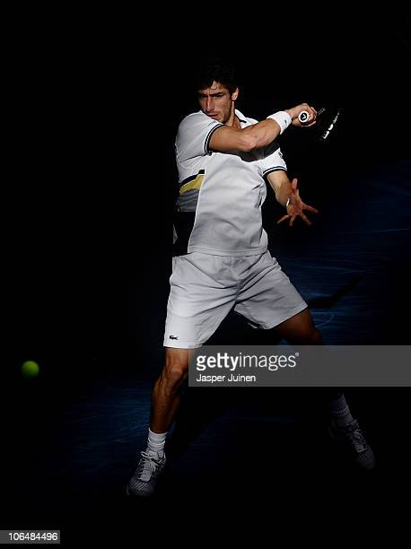 Pablo Cuevas of of Uruguay plays a backhand to Albert Ramos Vinolas of Spain in his first round match during the ATP 500 World Tour Valencia Open...