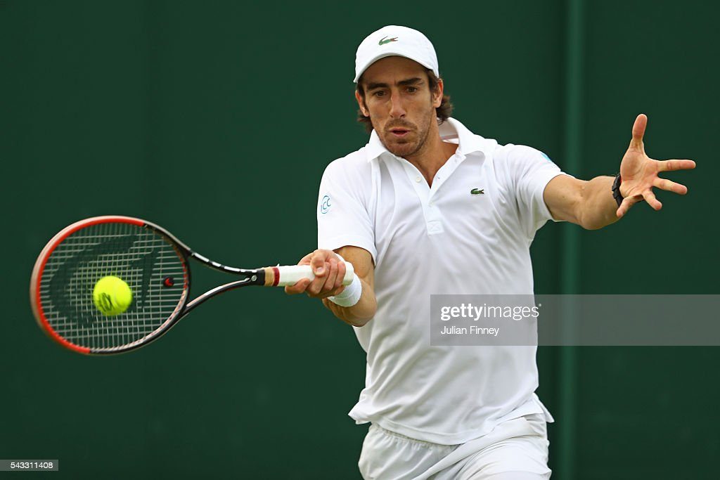 <a gi-track='captionPersonalityLinkClicked' href=/galleries/search?phrase=Pablo+Cuevas&family=editorial&specificpeople=822084 ng-click='$event.stopPropagation()'>Pablo Cuevas</a> of Uraguay plays a forehand shot during the Men's Singles first round match against Andrey Kuznetsov of Russia on day one of the Wimbledon Lawn Tennis Championships at the All England Lawn Tennis and Croquet Club on June 27th, 2016 in London, England.