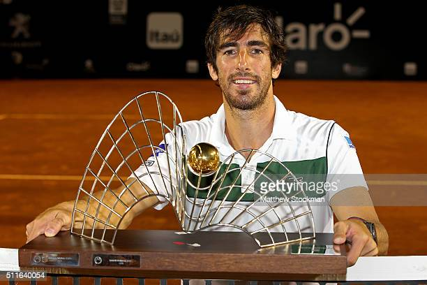 Pablo Cuevas of Uraguay poses for photographers after defeating Guido Pella of Argentina during the final of the Rio Open at Jockey Club Brasileiro...