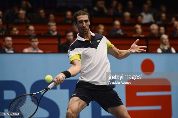 Pablo Cuevas of Uruguai in action against Marcelo Demoliner of Brazil and Sam Querrey of USA during Erste Bank Open 500 tournament doubles tennis...