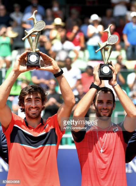 Pablo Cuevas of Uruguay and Guillermo Duran of Argentina celebrate with their trophies after winning the men's doubles event at the ATP tennis...