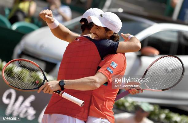 Pablo Cuevas of Uruguay and Guillermo Duran of Argentina celebrate after winning the men's doubles event at the ATP tennis tournament Generali Open...