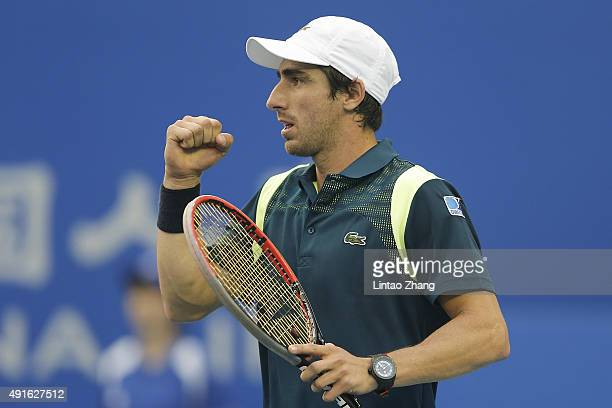 Pablo Cuevas of Uruguay celebrates a point against Tomas Berdych of the Czech Republic during the Men's singles first round match on day five of the...
