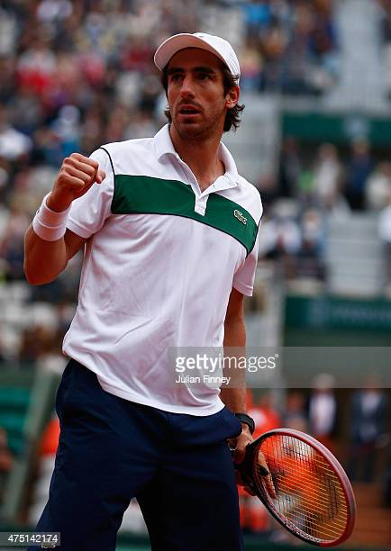 Pablo Cuevas of Uruguay celebrates a point in his Men's Singles match against Gael Monfils of France on day six of the 2015 French Open at Roland...
