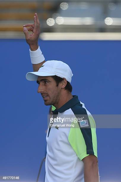 Pablo Cuevas of Uruguay celebrates after winning the match against Ivo Karlovic of Croatia during the day six of the 2015 China Open at the China...