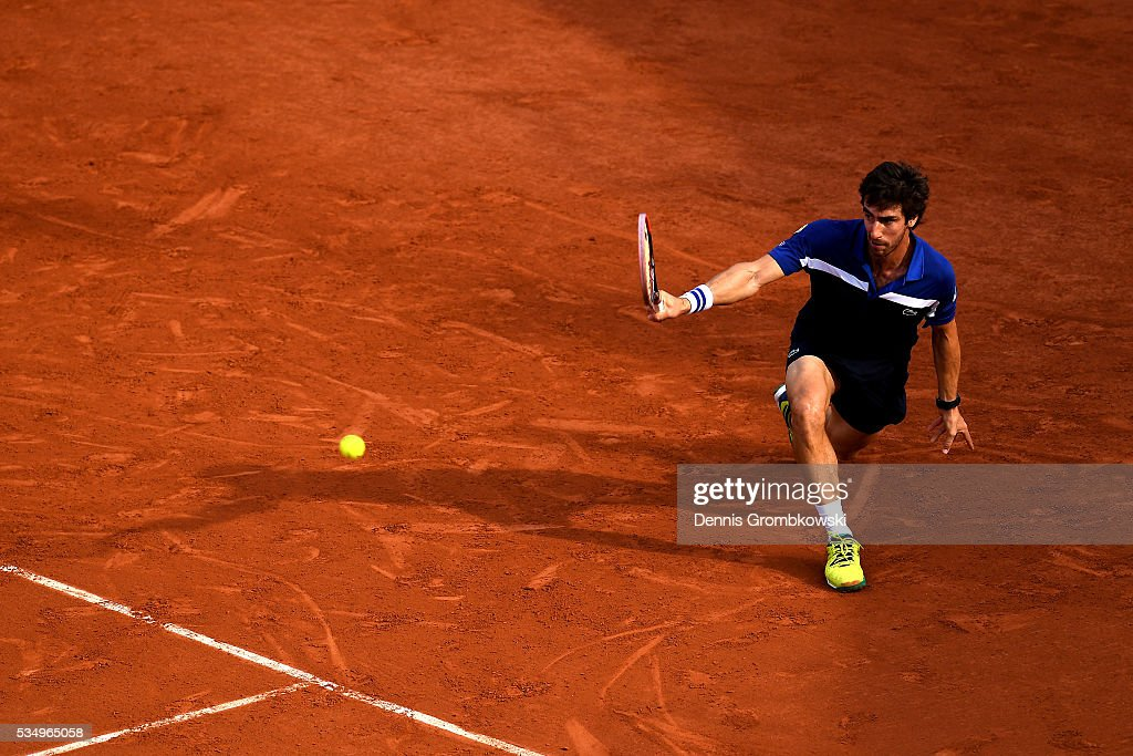 <a gi-track='captionPersonalityLinkClicked' href=/galleries/search?phrase=Pablo+Cuevas&family=editorial&specificpeople=822084 ng-click='$event.stopPropagation()'>Pablo Cuevas</a> of Uruguay hits a backhand during the Men's Singles third round match against **** on day seven of the 2016 French Open at Roland Garros on May 28, 2016 in Paris, France.