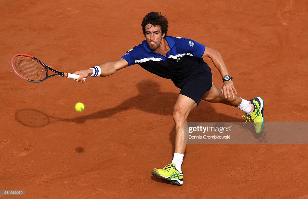 Pablo Cuevas of Uruguay hits a forehand during the Men's Singles third round match against **** on day seven of the 2016 French Open at Roland Garros on May 28, 2016 in Paris, France.