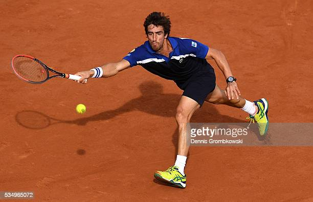 Pablo Cuevas of Uruguay hits a forehand during the Men's Singles third round match against **** on day seven of the 2016 French Open at Roland Garros...