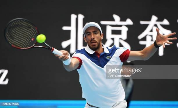 Pablo Cuevas of Uruguay hits a return during his men's singles match against Juan Martin Del Potro of Argentina at the China Open tennis tournament...