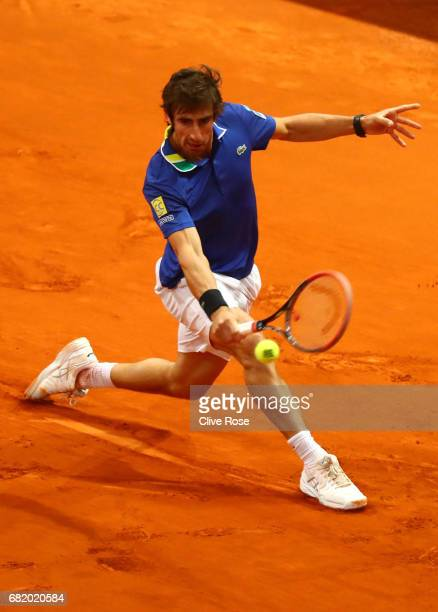 Pablo Cuevas of Uruguay in action against Benoit Paire of France on day six of the Mutua Madrid Open tennis at La Caja Magica on May 11 2017 in...