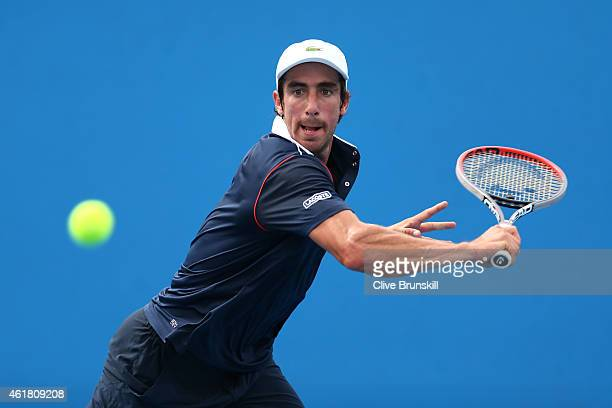 Pablo Cuevas of Uruguay plays a backhand in his first round match against Matthias Bachinger of Germany during day two of the 2015 Australian Open at...