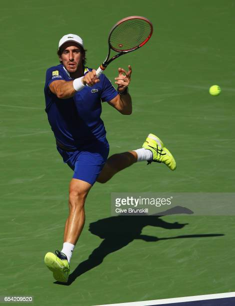 Pablo Cuevas of Uruguay plays a forehand against Pablo Carreno Busta of Spain in their quarter final match during day eleven of the BNP Paribas Open...