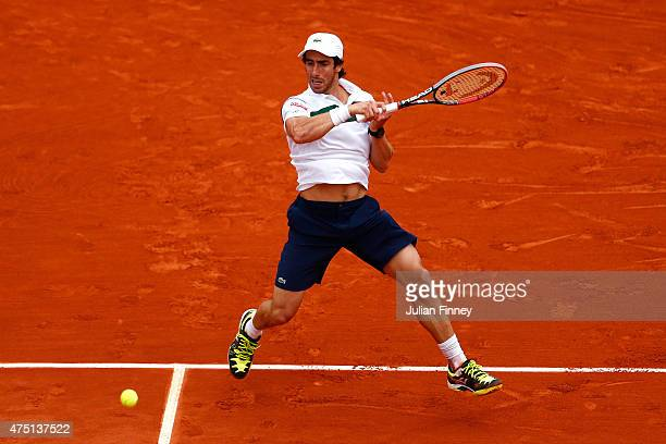 Pablo Cuevas of Uruguay plays a forehand in his Men's Singles match against Gael Monfils of France on day six of the 2015 French Open at Roland...