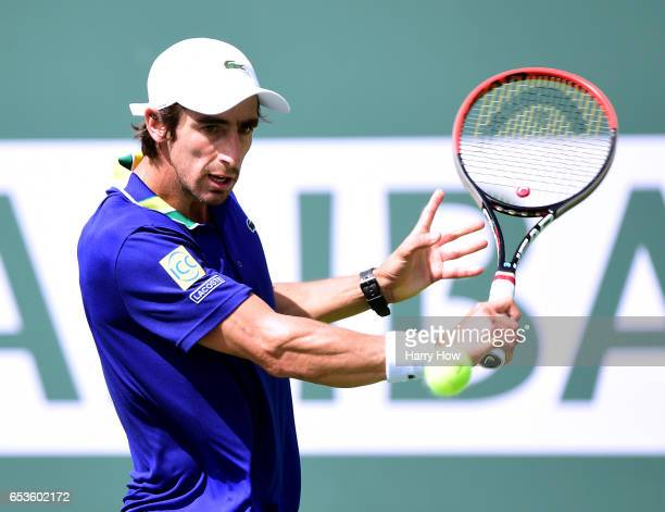 Pablo Cuevas of Uruguay prepares to hit a backhand in his win over David Goffin of Belgium during the BNP Paribas at Indian Wells Tennis Garden on...
