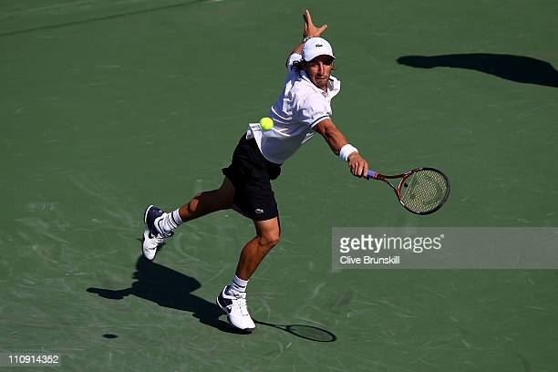 Pablo Cuevas of Uruguay reaches for a return against Andy Roddick during the Sony Ericsson Open at Crandon Park Tennis Center on March 26 2011 in Key...