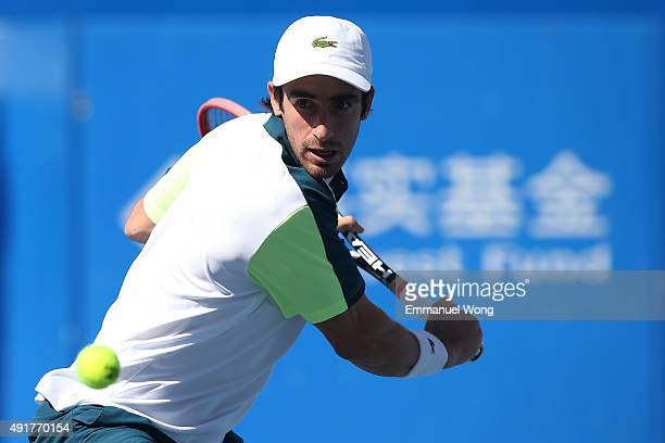 Pablo Cuevas of Uruguay returns a ball against Ivo Karlovic of Croatia during the day six of the 2015 China Open at the China National Tennis Center...