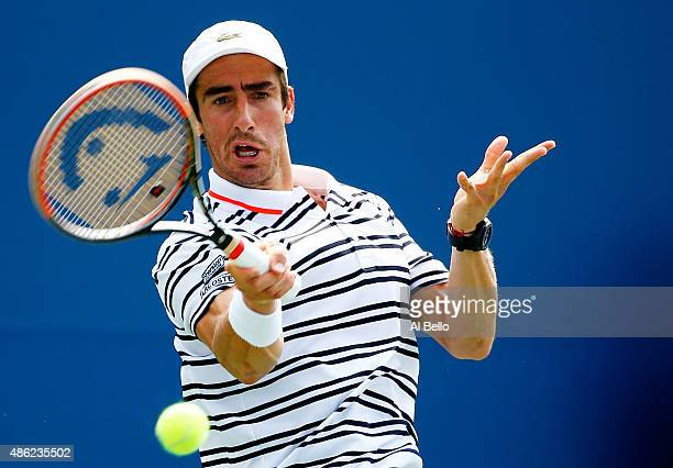 Pablo Cuevas of Uruguay returns a shot against Fabio Fognini of Italy during their Men's Singles Second Round match on Day Three of the 2015 US Open...
