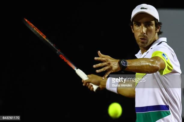 Pablo Cuevas of Uruguay returns a shot to Arthur de Greef of Belgium during the ATP Rio Open 2017 at Jockey Club Brasileiro on February 20 2017 in...