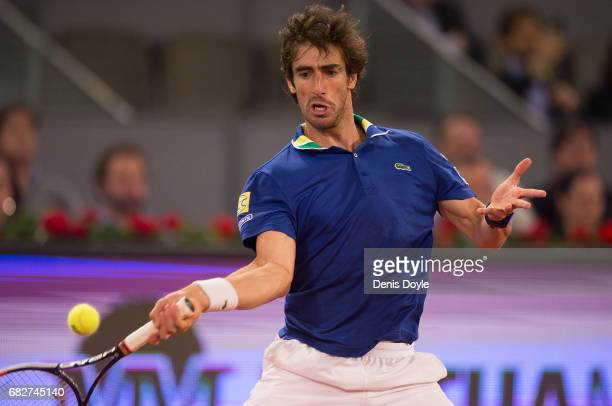 Pablo Cuevas of Uruguay returns a shot to Dominic Thiem of Austria in their semi finals match during day eight of the Mutua Madrid Open tennis at La...
