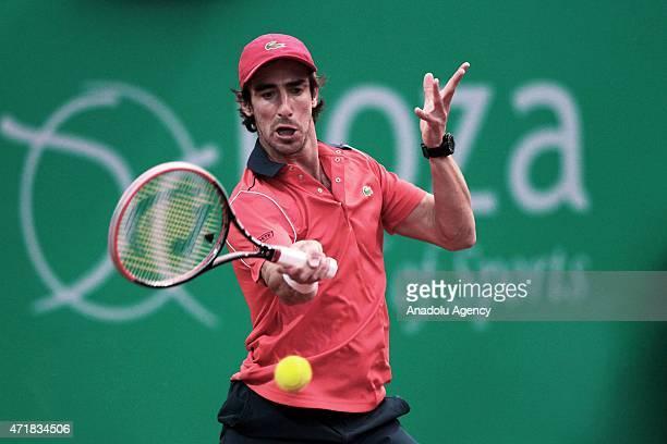 Pablo Cuevas of Uruguay returns ball to Thomaz Belluci of Brazil during men's single tennis match at Garanti Koza Arena during the TEB BNP Paribas...