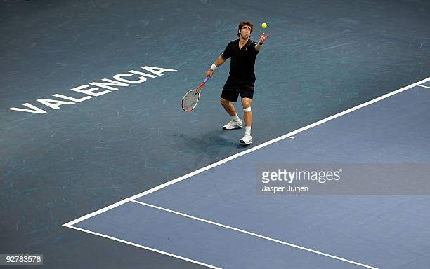 Pablo Cuevas of Uruguay serves the ball in his second round match against Mikhail Youzhny of Russia during the ATP 500 World Tour Valencia Open...