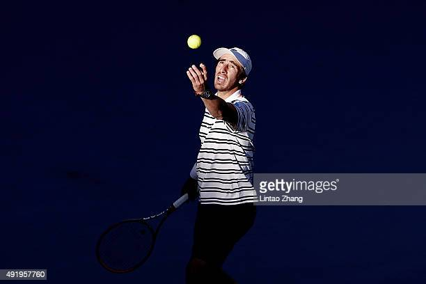 Pablo Cuevas of Uruguay serves to Fabio Fognini of Italy on day 7 of the 2015 China Open at the National Tennis Centre on October 9 2015 in Beijing...