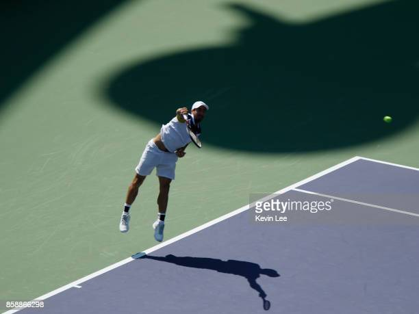 Pablo Cuevas of Uruguay serves to Jared Donaldson of United States during Men's first round match on Day 1 of 2017 ATP 1000 Shanghai Rolex Masters on...