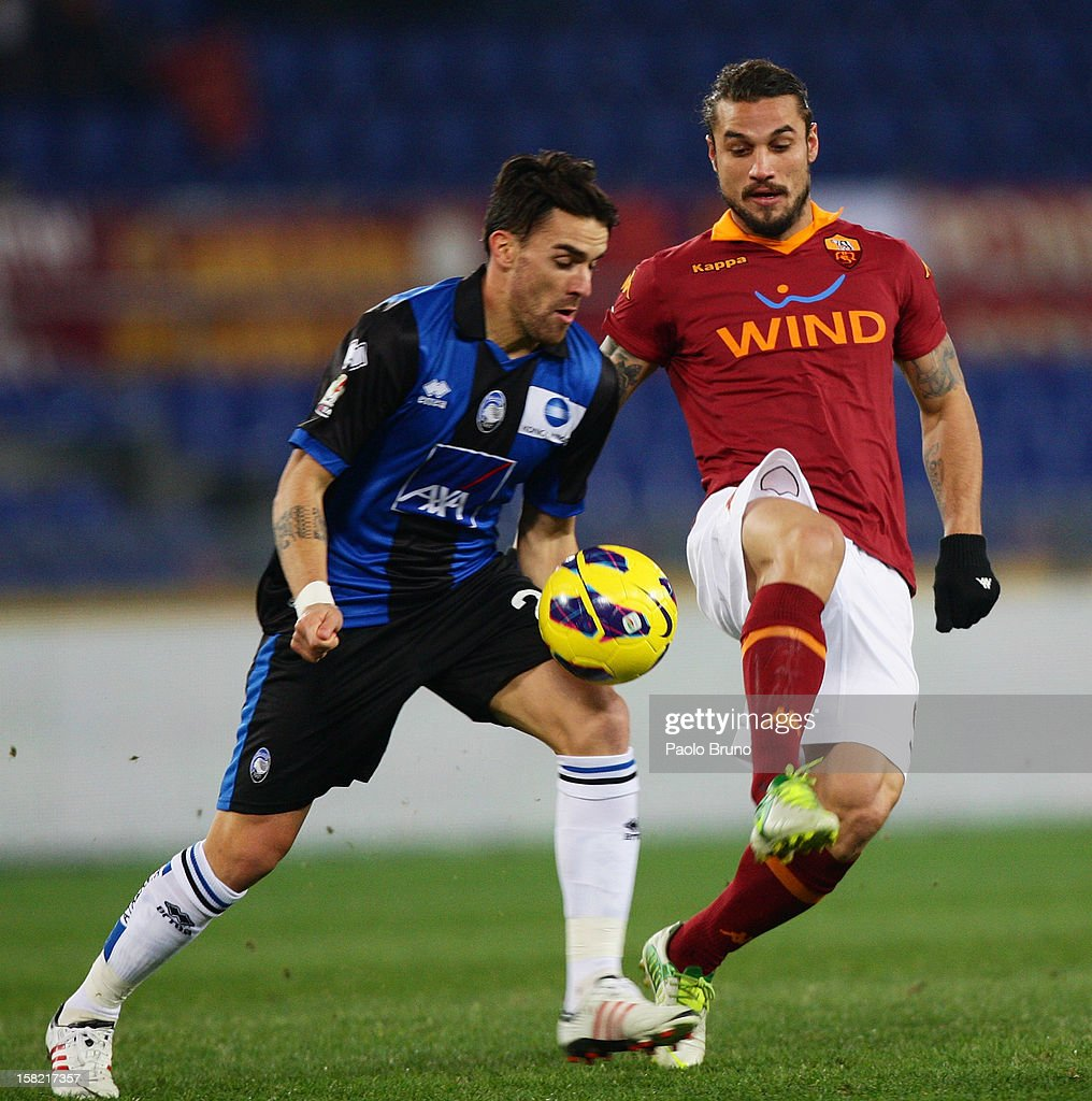 Pablo Daniel Osvaldo (R) of AS Roma competes for the ball with Luca Cigarini of Atalanta BC during the TIM Cup match between AS Roma and Atalanta BC at Olimpico Stadium on December 11, 2012 in Rome, Italy.