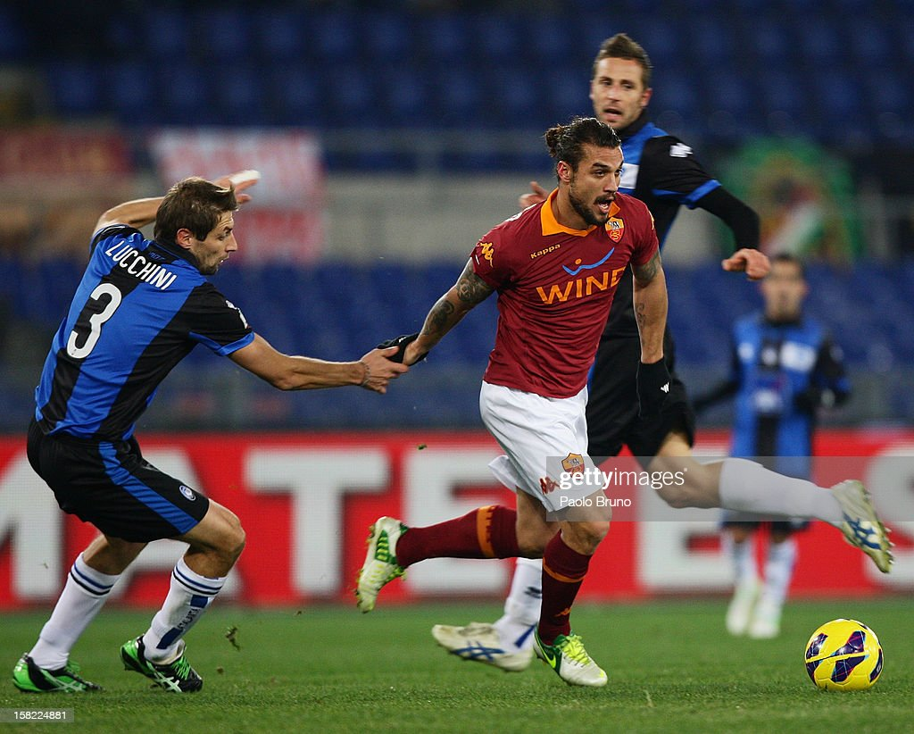 Pablo Daniel Osvaldo (R) of AS Roma competes for the ball with Stefano Lucchini of Atalanta BC during the TIM Cup match between AS Roma and Atalanta BC at Olimpico Stadium on December 11, 2012 in Rome, Italy.