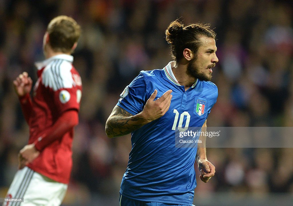 <a gi-track='captionPersonalityLinkClicked' href=/galleries/search?phrase=Pablo+Daniel+Osvaldo&family=editorial&specificpeople=4607628 ng-click='$event.stopPropagation()'>Pablo Daniel Osvaldo</a> of Italy celebrates after scoring the opening goal of the FIFA 2014 World Cup qualifier between Denmark and Italy on October 11, 2013 in Copenhagen, Denmark.